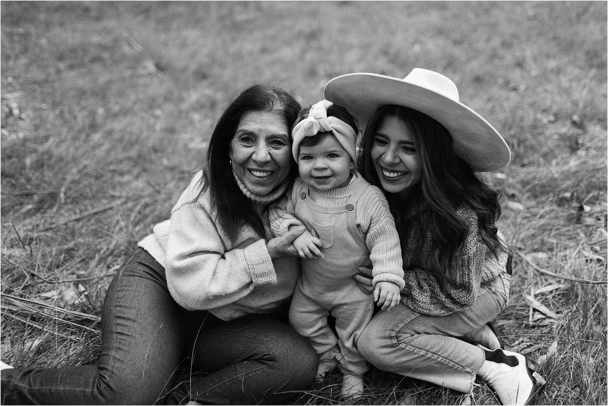Mum, Grandma and toddler cuddling